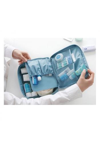 Dámská kosmetická taška s tečkovaným vzorem v mátové barvě