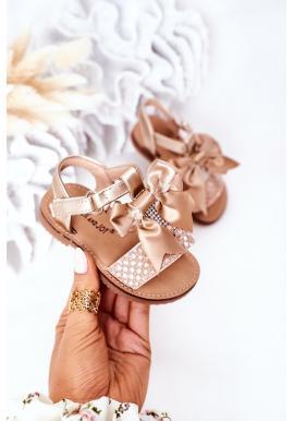 Trendy dětské sandály s mašličkou ve zlaté barvě
