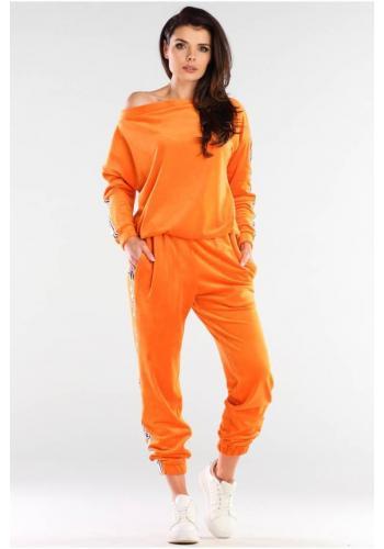 Velurové dámské tepláky oranžové barvy s kontrastními pásy